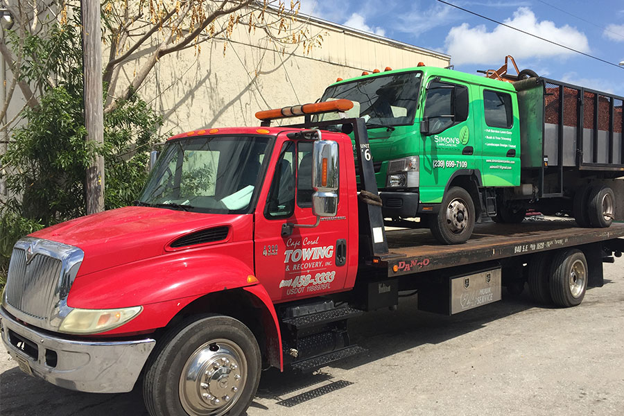 Read more about the article Tips for Safely Loading And Unloading A Flatbed Tow Truck